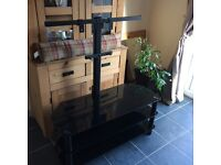 Black glass Tv mount stand. Very good condition will hold up to 50 inch Tv, fixing bolts included.
