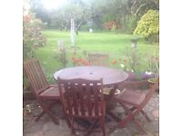 Solid wood round table and 4 chairs, all fold up for storage £40