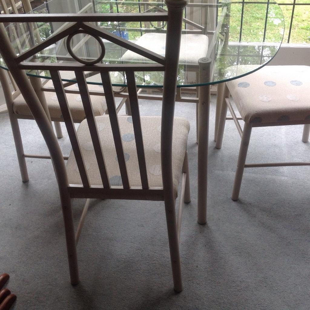 Kitchen dining table glass top four high back chairs good condition