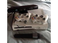 Xbox console, controllers, microphone, loads of games, kinect
