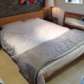 queensize wooden bed, cost 650.00