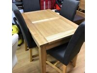 beautiful oak extending dining table with chairs