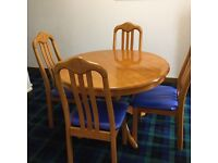 4 foot dia. Round dining table & chairs