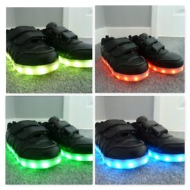 LED light up black trainers - child size 12 ½ (Eur 31).