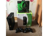 Xbox 360 - 4GB with two controllers & AX1-A Amplified stereo Headset.