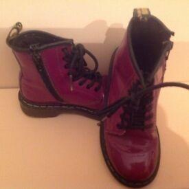 Girls Dr Martin purple boots.