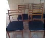 4 Dining or Kitchen chairs with padded seats.