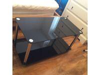 Glass chrome black tv unit