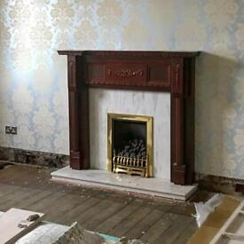 Wooden fire surround with marble hearth and inserts