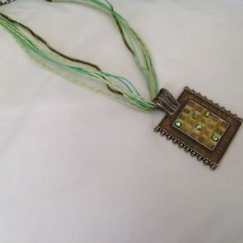 Cord and metal necklace
