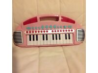 Child's toy piano battery operated