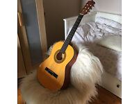 3/4 size guitar / child's acoustic guitar. 6 string, good condition, with digital tuning tool.