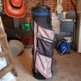 Golf clubs and 2 golf bags