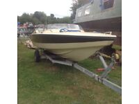 Speedboat with outboard engine and trailer