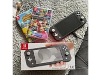 Nintendo Switch Lite (with mariokart & animal crossing)