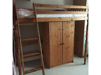wooden high sleeper bed with wardrobe