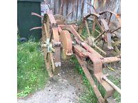 Vintage potato digger, plough, garden display, farm machine