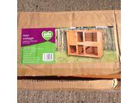 Luxury rabbit / ginny pig hutch rose cottage