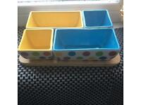 Colorful snack cups with wooden tray