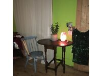 Oval Drop Leaf Dark Wooden Table , in very good condition