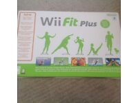 Nintendo Wii fit plus and 2 DVD's