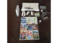 Nintendo Wii Bundle with 10 Games & Fitboard