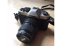 Nikon FM10 Camera and Black Leather Case