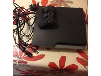 PS3 SLIMLINE WITH CONTROLLER AND 7 GAMES
