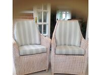 Two matching Cane tub style chairs with upholstered cushions in a stripe design very good condition