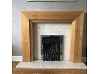 Oak fire surround and marble hearth and back
