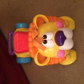 Fisher price sit , ride and stride lion.