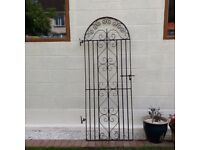 A Used wrought Iron Decorative Gate