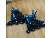 Two pairs of 'No Fear' roller blades for sale. One fits size 3-5 ladies, and one fits sizes 9-11 men