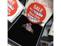 9ct Gold ring with purple and clear stones