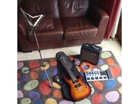 Electric Guitar, with Amp and synthesizer.