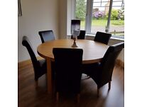 Stunning Round Dining Room Table with Leather Chairs and Matching Side Unit
