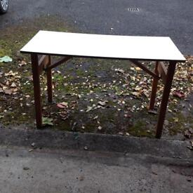 Strong folding table with white Formica top