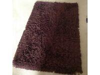Thick soft shagpile chocolate brown rug.