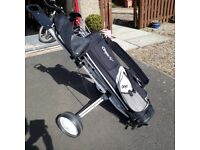 11 Right hand golf clubs in their bag, with trolley, balls & tees.