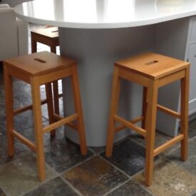 3 wooden kitchen stools