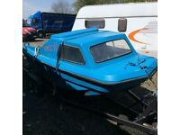 Dory fishing boat with outboard and trailer