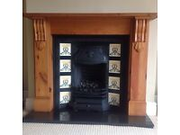 Cast iron fireplace with wood surround and granite hearth