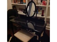 Beautiful black dressing table with matching stool.