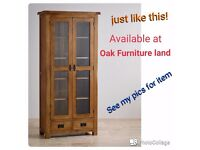 Display cabinet. Solid wood with glass windows. Excellent condition.