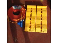 25m electric hook up cable + reel. Also pair of levelling ramps. For Motorhome or caravan use.