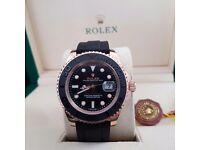 Black faced Rolex Yacht Master with black ceramic bezel, rose gold casing & all black rubber strap