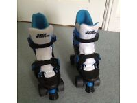 Roller Skates (NO FEAR), blue and white, adjustable child size 1 to 4. Light use, minor wear.
