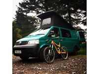 VW T5 Transporter camper van conversion. Pop top with roof bed