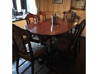 Solid wood dining table with 6 chairs and matching dresser