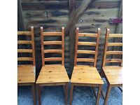Set of four pine dining chairs